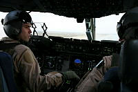 Royal Australian Air Force (RAAF) C-17A Globemaster III strategic airlifter pilot and aircraft captain Flight Lieutenant Ash Kissock confers with his co-pilot following their arrival at the rain-soaked El Gorah airfield in northeast Sinai, Egypt. This was the first time a RAAF C-17 had flown to the airfield, delivering a fresh rotation of Australian peacekeeping troops to the Multinational Force and Observers who continue to oversee the terms of the 1979 peace treaty between Egypt and Israel.