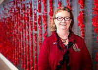 Jan-Maree Ball, the founder of Aussie Hero Quilts at the Australian War Memorial. Volunteers with Aussie Hero Quilts provide their time, skills and effort to manufacture highly valued quilts and laundry bags for personnel deployed on operations.