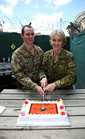 Australian Army soldier Corporal Joel Robertson and Commmander of Task Group Afghanistan and Head of Corps of the Royal Australian Corps of Military Police, Brigadier Cheryl Pearce cut the centenary bithday cake after their Corps Centenary parade at Hamid Karzai International Airport, Kabul Afghanistan on April 3.