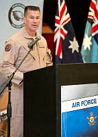 Outgoing Commander Task Unit 630.1, Group Captain David Smith, addresses Australian, United States Air Force and other coalition personnel during a Transfer of Authority ceremony at Australia's main air operating base in the Middle East region.
