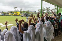 Students, from the Rakiraki Muslim Primary School, cheer as an Australian Army Taipan MRH-90 helicopter takes off for another mission during Operation Fiji Assist.