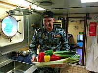 ABML-C Stephen Finnigan brings up a box of fresh vegetables for a midday meal.