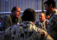 Senator The Hon David Johnston MP, discusses the situation in Afghanistan with members of the Australian Defence Force currently deployed to Kandahar Air Field in southern Afghanistan.