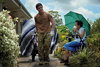 Soldiers from the Brisbane based 2nd/14th Light Horse Regiment assist with the cleanup effort at Liberty Villas Retirement Village in Bundaberg.
