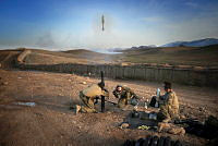 Soldiers from the 7th Battalion Royal Australian Regiment Task Group mortar section fire an 81mm high explosive mortar round while conducting training at Multi National Base - Tarin Kot.