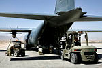 LMembers of the Air Load Team - Tarin Kot load a C-130 Hercules.