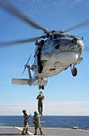 Royal Australian Navy Seahawk Helicopter 'Tiger 80' conducts a personnel transfer from HMAS Perth during Exercise Talisman Saber 2013.