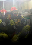 Able Seaman Marine Technician Jacqui Dunstan (left) and Able Seaman Electronic Technician Matthew Clements, fight a simulated fire during a fire fighting exercise in HMAS Perth.