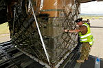 Corporal Michelle Drennan, from No. 1 Airfield Operations Support Squadron detachment Richmond, loads a pallet of equipment from Combined Task Force 635 (CTF 635) onto the No. 36 Squadron C-17 Globemaster in Honiara.