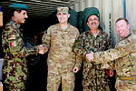 (L-R) Lieutenant Colonel Barum from the Afghan National Army (ANA) 4th Brigade 205th Corps (4/205),Staff Sergeant Jason W. Kelly from from the United States Infantry Training and Advisory Team -Tarin Kot, 4/205 Colonel Mohammed Akbar, Commander 4/205 Garrison Support Kandak and Major Shane Nicoll from Australian Army 2nd Cavalry Regiment Task Force Security Force Assistance Advisory Team (SFAAT) during the gifting of a shipping container of tools and equipment.