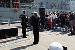 Commanding Officer HMAS Melbourne, Commander Brian Schlegel, RAN salutes Rear Admiral Timothy Barrett, AM, CSC, RAN, Commander Australian Fleet, on the wharf of Garden Island, Sydney, prior to HMAS Melbourne's departure for the Middle East Area of Operations.
