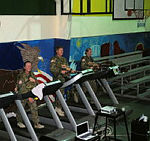(Operation MAZURKA personnel (from left) Sergeant Wendy Turnbull, Sergeant Jason Clark and Captain Nicole Maple pace away on the treadmills for a fundraising walk in the Sinai, Egypt.