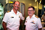 Commanding Officer HMAS MELBOURNE, Commander Brian Schlegel (left), greets Commander Combined Task Force 150, Commodore Daryl Bates, Royal Australian Navy (right), on board HMAS MELBOURNE.