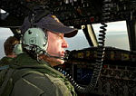 Royal Australian Air Force Warrant Officer Ron Day scans the ocean from the flight deck of an AP-3C Orion over the southern Indian Ocean search area as part of the Australian Maritime Safety Authority-led search for Malaysia Airlines flight MH370.