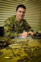 Australian Army soldier Private Joshua McMeikan of the Force Support Element (FSE) based at Australia's main support base in the Middle East region prepares to issue ammunition to troops entering Iraq and Afghanistan. FSE provides combat service support and in-theatre induction training for Australian Defence Force personnel in the Middle East region under Operation Accordion.