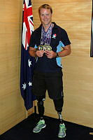 Sapper Curtis McGrath tells Minister for Defence Science and Personnel how he lost his legs in an IED blast in Afghanistan. Sapper McGrath, who won three gold medals at the US Marine Corps Trials, helped the ADF team to win a haul of 12 gold and three silver medals. The Trials were conducted at Camp Pendleton in the United States from February 20 to March 11 and form an important part of the ADF Paralympic Sports Program's 'Exercise Wounded Warrior Program'. His golden triumphs were in the 50m and 100m freestyles, and the 50m backstroke, not only won the respect of his team-mates and rival competitors but marked a major milestone in his recovery progress.