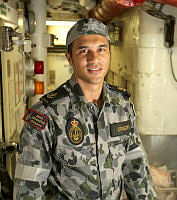 Leading Seaman Jude Gregory in the fridge flat onboard HMAS Newcastle.