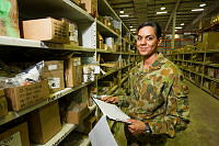 Lance Corporal Natalie Whyte, a warehouse storeman with Force Support Unit checks the stores at the at Al Minhad Air Base, in the United Arab Emirates.