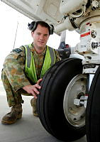 Royal Australian Air Force aircraft technician Leading Aircraftman Matthew Burke from No.11 Squadron, inspects the nose wheel of an AP-3C Orion at RAAF Base Townsville during Exercise Talisman Saber 2013.
