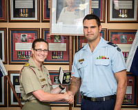 Lieutenant Colonel Berlioz Nott presents Corporal Coomara Munro with the Humanitarian Overseas Service Medal for his contribution to Operation Pakistan Assist II at Royal Military College, Duntroon, Canberra.