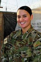 Private Angela Paulo near the front gate of Camp BAKER, Kandahar, Afghanistan