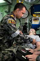 HMAS Darwn's Medical Officer, Lieutenant Beimop Tapim, RAN, conducts a medical check of a member of ships company.
