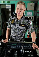 Midshipman Patrick Mandall looks over the Bridge Controls onboard HMAS Choules, Sydney, as part of the Navy's New Entry Officer Course sea training deployment.