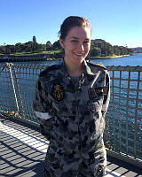Able Seaman Maritime Logistics Steward onboard HMAS Stuart's flight deck, where she participates as a member of the Flight Deck Team during helicopter operations