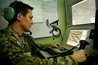 Flight Lieutenant Matthew Basedow, Air Combat Officer (Airborne Electronics), controls the Heron Remotely Piloted Aircraft in the Aircraft Control Station at Kandahar AIr Field in Afghanistan.