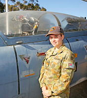 LACW Jess Scully of No. 24 Squadron RAAF, beside a Macchi aircraft at RAAF Base Edingburgh on October 3, 2014.