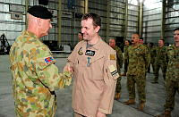 Commander Joint Task Force 633 Major General Craig Orme, AC presents Royal Australian Air Force Pilot, Squadron Leader Sam Wright the Australian Operational Service Medal as part of Operation Accordion.