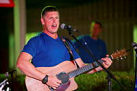 Lance Corporal David Andrews from the Band of the 1st Battalion, the Royal Australian Regiment (1 RAR Band) performs during the Forces Entertainment Tour to the Middle East.
