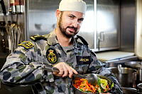 Able Seaman Maritime Logistics - Chef Robert Johnson prepares a fresh salad of the crew of HMAS Brunei during the ship's final deployment before being decommissioned in November 2014.