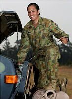 Army Reservist Private Lauren Berryman, from 13 Brigade, checks the engine of her Unimog truck which had been used to haul tents and other stores in support of Operation Northcliffe Assist.