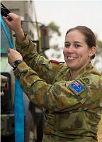 Army Reservist Private Morag Mcgregor, from 13 Brigade, tightens a load strap on a Unimog truck which had been used to haul tents and other stores in support of Operation Northcliffe Assist.
