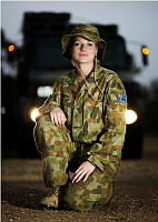 Australian Army Transport Corps Reservist, Private Emmalissa Llyod from 13th Brigade, pauses in front of her Unimog truck which had been used to haul tents and other stores in support of Operation Northcliffe Assist.