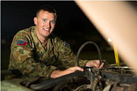 Royal Australian Electrical and Mechanical Engineers Corporal James Black, from 13 Brigade, is supporting Operation Northcliffe Assist by conduction vehicle maintenance on an Army 6x6 Landrover vehicle.