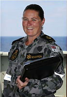 Chief Petty Officer Naval Police Coxswain Rachelle Henderson is seen with her service police notebook during an exercise onboard HMAS Success while deployed on Operation MANITOU.
