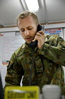 Royal Australian Air Force Leading Aircraftman Barton Hoglund passes on informatione during his deployment to the Middle East Region.