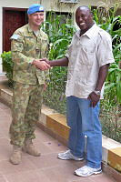 Royal Australian Air Force Flight Lieutenant Karl Woodward with John Waykono, a locally employed civilian that works in support of Australians in South Sudan.