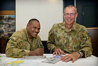 Australian Army soldiers Sergeant Troy Stow (left) and Warrant Officer Class Two Alan Shirt conduct planning for water-borne patrol and surveillance training throughout the Torres Strait region.