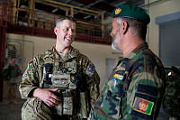 Australian Army soldier Sergeant Dominic Buchan (left) greets Afghan National Army officer Major Fazil Rabi, the 205th Corps Maintenance Company Commander, during a visit to the maintenance workshop at Camp Hero, Kandahar. Sergeant Buchan provides expert advice to the Afghan National Army's 205th Corps Technical Officer and Maintenance Company Commander.