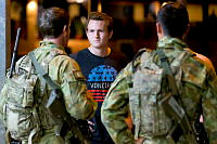 Brisbane based soldiers from the Ready Combat Team Corporal Kyle Johnson (left) and Lance Corporal Muhammad Bin Sahid Kamsin chat with Jacques de Wet, during a night security patrol as part of Exercise Northern Shield 2015.