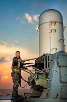 Royal Australian Navy sailor Leading Seaman Electronics Technician Stephanie Horswood maintains the Phalanx Close-In Weapons System used for anti-missile defence while deployed aboard HMAS Melbourne, which is patrolling in the Middle East Region as part of Operation Manitou.