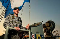 Royal Australian Navy sailor Seaman Communications Information Systems Blake Ridge breaks HMAS Melbournes International Callsign aboard the warship. Seaman Ridge is deployed aboard HMAS Melbourne, which is patrolling the Middle East Region as part of Operation Manitou.