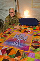 Air Force Chaplain, Squadron Leader Robyn Kidd, shows off her hand made Aussie Hero quilt.