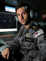 Leading Seaman Combat Systems Operator Alex Zourkas on console in HMAS Canberra's Operations Room while enroute to Hawaii to participate in Exercise Rim of the Pacific (RIMPAC) 16.