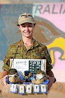Royal Australian Air Force Leading Aircraftwoman Melinda Bridge displays Legacy merchandise she is selling at Australia's main operating air base in the Middle East Region in support of Legacy Week 2016.