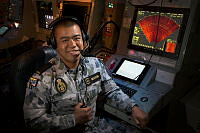 Royal Australian Navy Seaman Tuan Nguyen at his console in the operations room aboard HMAS Diamantina during Operation Render Safe 2016 in the Solomon Islands.