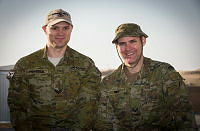 Royal Australian Air Force airman, Corporal Mark Peacock (left) and Australian Army Reservist, Corporal Phillip Rule are deployed to the Middle East on Operation Accordion. They are old friends from Hobart and had an unexpected opportunity to catch up on old times while Phillip was transiting through the main Australian logistic base while returning home after a deployment to Afghanistan.